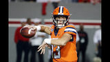 Syracuse's Tommy DeVito (13) looks to pass the ball against North Carolina State during the first half of an NCAA college football game in Raleigh, N.C., Thursday, Oct. 10, 2019. (AP Photo/Karl B DeBlaker)
