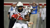 North Carolina State's Zonovan Knight (24) takes the handoff from Bailey Hockman (16) during the first half of an NCAA college football game against Syracuse in Raleigh, N.C., Thursday, Oct. 10, 2019. (AP Photo/Karl B DeBlaker)