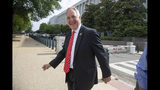 FILE - In this June 13, 2018, file photo, Rep. John Shimkus, R-Ill., leaves a closed-door GOP meeting on Capitol Hill in Washington. Retiring House and Senate Republicans are a natural group to watch for defectors as Democrats' impeachment inquiry of President Donald Trump builds steam. (AP Photo/J. Scott Applewhite, File)
