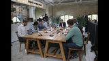"Ukrainian President Volodymyr Zelenskiy, center, speaks during talks with journalists in Kyiv, Ukraine, Thursday, Oct. 10, 2019. Ukrainian President is holding an all-day ""media marathon"" in a Kyiv food court amid growing questions about his actions as president. (AP Photo/Efrem Lukatsky)"