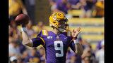 LSU quarterback Joe Burrow (9) throws a pass in the first half of an NCAA college football game against Utah State in Baton Rouge, La., Saturday, Oct. 5, 2019. (AP Photo/Gerald Herbert)