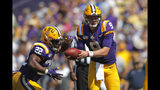 LSU quarterback Joe Burrow (9) hands off to running back Clyde Edwards-Helaire (22) in the first half of an NCAA college football game against Utah State in Baton Rouge, La., Saturday, Oct. 5, 2019. LSU won 42-6. (AP Photo/Gerald Herbert)