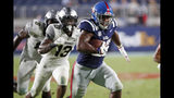 Mississippi running back Scottie Phillips (22) runs past Vanderbilt safety Brendon Harris (13) on his way to a 24-yard touchdown during the second half of an NCAA college football game in Oxford, Miss., Saturday, Oct. 5, 2019. Mississippi won 31-6. (AP Photo/Rogelio V. Solis)