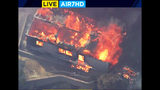 This photo from video provided by KABC-TV shows strong, gusting winds pushing flames through the Villa Calimesa mobile home park in Calimesa, Calif., southeast of San Bernardino, Thursday, Oct. 10, 2019. Multiple residences have burned in the fire that started shortly after noon. (KABC-TV via AP)