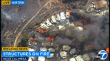 This photo from video provided by KABC-TV shows Strong, gusting winds push flames through the Villa Calimesa mobile home park in Calimesa, Calif., southeast of San Bernardino, Thursday, Oct. 10, 2019. Multiple residences have burned in the fire, that started shortly after noon. (KABC-TV via AP)