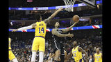 Brooklyn Nets' Wilson Chandler goes to the basket against Los Angeles Lakers' Danny Green, left, during a preseason NBA game in Shanghai, China, Thursday, Oct. 10, 2019. (AP Photo)