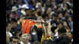 A child holds up two Chinese national flags as she watches a preseason NBA basketball game between the Brooklyn Nets and Los Angeles Lakers at the Mercedes Benz Arena in Shanghai, China, Thursday, Oct. 10, 2019. (AP Photo)