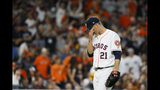 Houston Astros starting pitcher Zack Greinke reacts after giving up a home run to New York Yankees' Giancarlo Stanton during the sixth inning in Game 1 of baseball's American League Championship Series Saturday, Oct. 12, 2019, in Houston. (AP Photo/Matt Slocum)