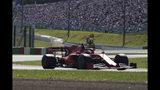 El alemán Sebastian Vettel conduce su Ferrari durante la clasificación para el Gran Premio de Japón, el domingo 13 de octubre de 2019 (AP Foto/Toru Hanai)