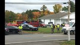 RETRANSMITTED WITH NEW SLUG AND BETTER QUALITY - In this photo provided by WMUR-TV, police stand outside the New England Pentecostal Church after reports of a shooting on Saturday, Oct. 12, 2019, in Pelham, N.H. WMUR-TV reports that Hillsborough County Attorney Michael Conlon said a suspect is in custody. (Siobhan Lopez/WMUR-TV via AP)