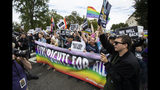 Supporters of LGBT rights stage a protest on the street in front of the U.S. Supreme Court, Tuesday, Oct. 8, 2019, in Washington. The Supreme Court heard arguments in its first cases on LGBT rights since the retirement of Justice Anthony Kennedy. (AP Photo/Manuel Balce Ceneta)