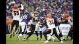 Cincinnati Bengals linebacker LaRoy Reynolds (55) blocks a pass from Baltimore Ravens quarterback Lamar Jackson, center, during the second half of a NFL football game Sunday, Oct. 13, 2019, in Baltimore. (AP Photo/Nick Wass)