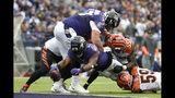 Baltimore Ravens running back Mark Ingram (21) dives in for a touchdown on a run as Cincinnati Bengals linebacker LaRoy Reynolds (55) and outside linebacker Nick Vigil (59) try to stop him during the first half of a NFL football game Sunday, Oct. 13, 2019, in Baltimore. (AP Photo/Gail Burton)