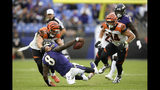 Cincinnati Bengals outside linebacker Nick Vigil (59) makes a hit on Baltimore Ravens quarterback Lamar Jackson (8) during the second half of a NFL football game Sunday, Oct. 13, 2019, in Baltimore. (AP Photo/Nick Wass)