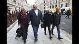 The family Harry Dunn, mother Charlotte Charles, second right, and father Tim Dunn, second left, arrive with their partners at the Foreign and Commonwealth Office in London, where they are meeting British Foreign Secretary Dominic Raab, Wednesday Oct. 9, 2019. The couple's son 19-year old Harry Dunn was killed in a road accident Aug. 27, involving an American diplomat's wife who left the country under Diplomatic Immunity after reportedly becoming a suspect in the fatal crash. (Jonathan Brady/PA via AP)
