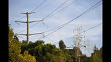 A view of electrical power lines near Moraga Way in Orinda, Calif., on Thursday, Oct. 10, 2019. Business continue to be closed due to the recent Pacific Gas and Electric shutdown. The utility began restoring power to Bay Area residents Thursday, taking the first steps in what could be a days-long process to end an outage that left many homes and businesses in the dark. (Jose Carlos Fajardo/East Bay Times via AP)