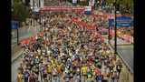 Runners start the Bank of America Chicago Marathon on Sunday, Oct. 13, 2019, in Chicago. (AP Photo/Paul Beaty)