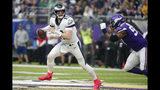 Philadelphia Eagles quarterback Carson Wentz, left, runs form Minnesota Vikings defensive end Everson Griffen, right, during the first half of an NFL football game, Sunday, Oct. 13, 2019, in Minneapolis. (AP Photo/Bruce Kluckhohn)