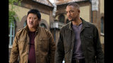 """This image released by Paramount Pictures shows Benedict Wong, left, and Will Smith in a scene from the Ang Lee film """"Gemini Man."""" (Ben Rothstein/Paramount Pictures via AP)"""