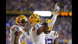 LSU wide receiver Ja'Marr Chase (1) celebrates his touchdown reception in the second half of an NCAA college football game against Florida in Baton Rouge, La., Saturday, Oct. 12, 2019. LSU won 42-28. (AP Photo/Gerald Herbert)