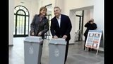 Hungarian Prime Minister Viktor Orban of the governing Fidesz party and his wife, Aniko Levai cast their ballots at the nationwide local elections in Budapest, Hungary, Sunday, Oct. 13, 2019. (Szilard Koszticsak/MTI via AP)