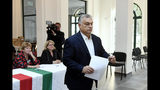 Hungarian Prime Minister Viktor Orban of the governing Fidesz party prepares to cast his ballot at the nationwide local elections in Budapest, Hungary, Sunday, Oct. 13, 2019. (Szilard Koszticsak/MTI via AP)