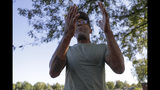Kevin Bryant discusses the impeachment inquiry into President Donald Trump while walking in a park,Wednesday, Oct. 9, 2019, in Fishers, Ind. (AP Photo/Darron Cummings)