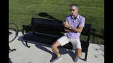 Randall Scott discusses the impeachment inquiry into President Donald Trump while sitting in a park in the Nickel Plate District, Wednesday, Oct. 9, 2019, in Fishers, Ind. (AP Photo/Darron Cummings)