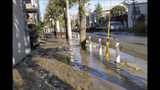This image made from a video by @ar_kaz shows the mud covered street after the flood water receded on the morning Sunday, Oct. 13, 2019, in Kawasaki, near Tokyo, Japan. Helicopters plucked people from their flooded homes on Sunday as rescue efforts went into full force in wide areas of Japan, including Tokyo, after a powerful typhoon unleashed heavy rainfall.(@ar_kaz via AP)