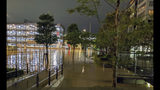 This Oct. 12, 2019 photo by @ar_kaz shows the flooded streets in Kawasaki, near Tokyo, Japan. Helicopters plucked people from their flooded homes on Sunday as rescue efforts went into full force in wide areas of Japan, including Tokyo, after a powerful typhoon unleashed heavy rainfall.(@ar_kaz via AP)