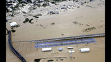 Rows of Japan's bullet trains, parked in a facility, sit in a pool of water in Nagano, central Japan, after Typhoon Hagibis hit the city, Sunday, Oct. 13, 2019. Rescue efforts for people stranded in flooded areas are in full force after a powerful typhoon dashed heavy rainfall and winds through a widespread area of Japan, including Tokyo.(Yohei Kanasashi/Kyodo News via AP)