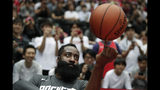 Houston Rockets' James Harden spins the ball during warmups for the team's NBA preseason basketball game against the Toronto Raptors Thursday, Oct. 10, 2019, in Saitama, near Tokyo. (AP Photo/Jae C. Hong)