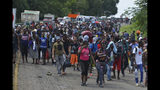 Migrants walk down Highway 200 en route to Huixtla near Tapachula, Chiapas state, Mexico, Saturday Oct. 12, 2019. Migrants from Africa, Cuba, Haiti, and other Central American countries set off early morning by foot from Tapachula to the southern border of the United States. (AP Photo/Isabel Mateos)