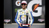 Monster Energy NASCAR Cup Series driver Chase Elliott wins the pole for the 1000Bulbs.com 500 at Talladega Superspeedway, Saturday, Oct 12, 2019, in Talladega, Ala. (AP Photo/Butch Dill)