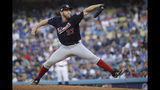 Washington Nationals starting pitcher Stephen Strasburg throws to a Los Angeles Dodgers batter during the first inning in Game 5 of a baseball National League Division Series on Wednesday, Oct. 9, 2019, in Los Angeles. (AP Photo/Marcio Jose Sanchez)