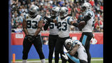 Carolina Panthers cornerback Javien Elliott (23) celebrates with teammates after intercepting a pass against the Tampa Bay Buccaneers during the second quarter of an NFL football game, Sunday, Oct. 13, 2019, at Tottenham Hotspur Stadium in London. (AP Photo/Tim Ireland)