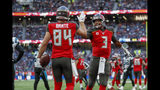 Tampa Bay Buccaneers tight end Cameron Brate (84) celebrates with quarterback Jameis Winston (3) after making a touchdown catch against the Carolina Panthers during the fourth quarter of an NFL football game, Sunday, Oct. 13, 2019, at Tottenham Hotspur Stadium in London. (AP Photo/Alastair Grant)