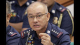 FILE - In this Oct. 3, 2019, file photo, Philippine National Police chief Gen. Oscar Albayalde gestures as he testifies at the resumption of the Senate probe on the release of hundreds of convicts under the shortened serving of their sentence for good behavior, in suburban Pasay city, south of Manila, Philippines. Albayalde has resigned after he faced allegations in a Senate hearing that he intervened as a provincial police chief in 2013 to prevent his officers from being prosecuted for allegedly selling a huge quantity of seized drugs. (AP Photo/Bullit Marquez, File)