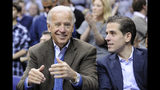 FILE - In this Jan. 30, 2010, file photo, Vice President Joe Biden, left, with his son Hunter, right, at the Duke Georgetown NCAA college basketball game in Washington. Since the early days of the United States, leading politicians have had to contend with awkward problems posed by their family members. Joe Biden is the latest prominent politician to navigate this tricky terrain. (AP Photo/Nick Wass, File)