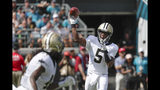 New Orleans Saints quarterback Teddy Bridgewater (5) throws a pass to running back Alvin Kamara, left, during the first half of an NFL football game against the Jacksonville Jaguars, Sunday, Oct. 13, 2019, in Jacksonville, Fla. (AP Photo/John Raoux)