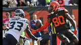 Seattle Seahawks free safety Tedric Thompson (33) intercepts pass for Cleveland Browns wide receiver Jarvis Landry (80) in the end zone during the first half of an NFL football game, Sunday, Oct. 13, 2019, in Cleveland. (AP Photo/Ron Schwane)