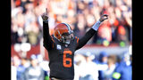 Cleveland Browns quarterback Baker Mayfield celebrates a 3-yard touchdown by running back Nick Chubb during the second half of an NFL football game against the Seattle Seahawks, Sunday, Oct. 13, 2019, in Cleveland. (AP Photo/David Richard)