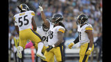 Pittsburgh Steelers outside linebacker Bud Dupree, second from right, celebrates a tackle with linebacker Devin Bush, left, inside linebacker Vince Williams, second from right, and defensive end Cameron Heyward during the first half of an NFL football game against the Los Angeles Chargers, Sunday, Oct. 13, 2019, in Carson, Calif. (AP Photo/Kyusung Gong)