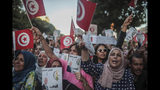 Supporters of independent Tunisian Presidential candidate Kais Saied attend a rally on the last day of campaigning before the second round of the presidential elections, in Tunis, Tunisia, Friday, Oct. 11, 2019. (AP Photo/Mosa'ab Elshamy)