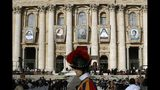 Tapestries hanging from the facade of St. Peter's Basilica portray from left, Dulce Lopes Pontes, Giuseppina Vannini, John Henry Newman, Maria Teresa Chiramel Mankidiyan, and Margarita Bays, in St. Peter's Square at the Vatican, Sunday, Oct. 13, 2019. Pope Francis canonizes Cardinal John Henry Newman, the 19th century Anglican convert who became an immensely influential thinker in both Anglican and Catholic churches, and four other women. (AP Photo/Alessandra Tarantino)