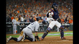 Houston Astros catcher Robinson Chirinos, right, celebrates after tagging out New York Yankees' DJ LeMahieu who tried to score on a single by Brett Gardner during the sixth inning in Game 2 of baseball's American League Championship Series Sunday, Oct. 13, 2019, in Houston. (AP Photo/Matt Slocum)