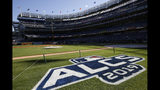 The field is prepped with signage for the American League Championship Series between the New York Yankees and the Houston Astros at Yankee Stadium, Monday, Oct. 14, 2019, in New York. Game 4 in the series, tied at 1-1, is scheduled for Tuesday. (AP Photo/Kathy Willens)