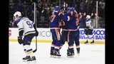 New York Islanders players celebrate their overtime goal in an NHL hockey game against the St. Louis Blues, Monday, Oct. 14, 2019, in Uniondale, N.Y. (AP Photo/Kathleen Malone-Van Dyke)