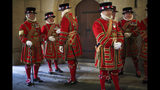 Members of the Yeoman Guard ahead of the official State Opening of Parliament in London, Monday Oct. 14, 2019. (Hannah McKay/Pool via AP)