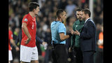 England manager Gareth Southgate, right, speaks with Referee Ivan Bebek during the Euro 2020 group A qualifying soccer match between Bulgaria and England, at the Vasil Levski national stadium, in Sofia, Bulgaria, Monday, Oct. 14, 2019. (AP Photo/Andreea Alexandru)